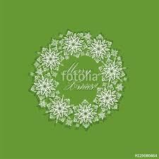 greeting green xmas card with paper cut out decorative snowflakes