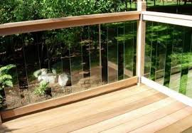 backyard deck with furniture and glass deck railing glass deck