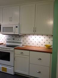 kitchen decora cabinetry simsbury maple door paint white finish