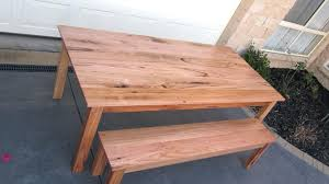 rustic outdoor dining table with unfinished mahogany bench of
