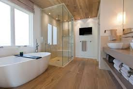 modern bathroom design trends with glass shower door and wood