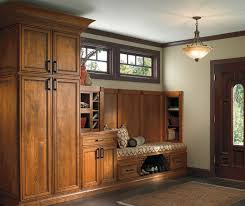 rustic alder cabinets in a bar area schrock cabinetry