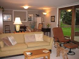 living room design with cream linen love seat and dark brown side