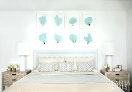 white distressed headboard white and blue bedroom with turquoise