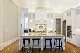 luxury eat in kitchen with white cabinets and granite counters