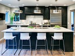transitional kitchen design with black cabinet and white chairs