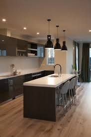 engineered timber flooring runs throughout the open plan living and