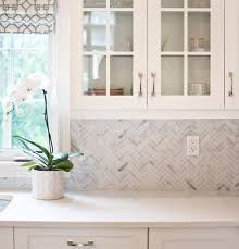 glass cabinets in white kitchen design a minimalist kitchen with these 15 ideas
