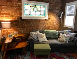 our living room with original brick and stained glass cozyplaces