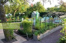 gap gardens rustic pergola with sweetpeas and vegetable garden