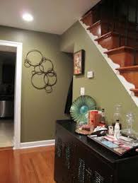 image result for vaulted ceiling living room accent wall green