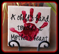 diy christmas gift idea tile a child u0027s hand touches a