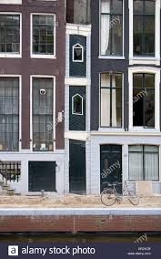 Narrow Houses Holland Amsterdam Row Of Old Canal Side Houses With One Very