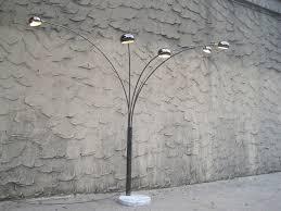 lighting fantastic arc floor lamp and concrete wall plus concrete