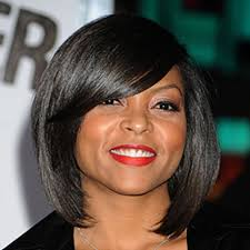 pic of black women side swept bangs and bun hairstyle hot hair side swept bangs essence com