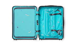 away u0027s new collaboration with gray malin lines its luggage with