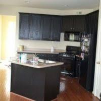 u shape kitchen decoration using black wood glass front distressed
