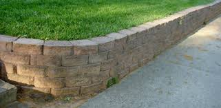 How To Lay Patio Stones by How To Build A Stackable Block Retaining Wall Today U0027s Homeowner