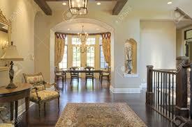 grand foyer with area rug and view to dining room stock photo