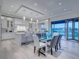 kitchen hanging lights wood bar stools beige countertop transomw indows soffit glass