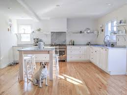 white kitchen cabinets yes or no the no backsplash alternative to subway tile before after