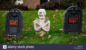 a mummy between two gravestones labeled u0027vacancy u0027 decorates a