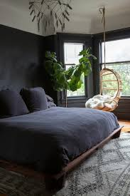 black walls in bedroom in black 31 exles that black bedrooms are stylish and