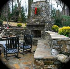 Backyard Stone Patio Designs by Fireplace Seating Wall And Stone Patio Landscaping By Eden