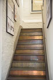 Stair Ideas | patinated brass cladding on stairs pinteres