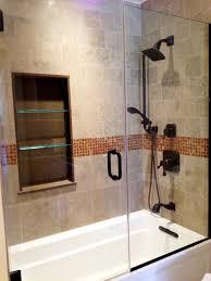 white marble panel corner tub beside glass shower room and dark