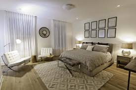 traditional master bedroom with flush light hardwood floors in