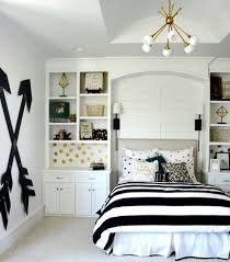 bedroom sputnik chandelier and black and white bedding also wall