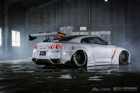 nissan gtr tanner fox matte white liberty walk nissan gt r r35 rear side view japan