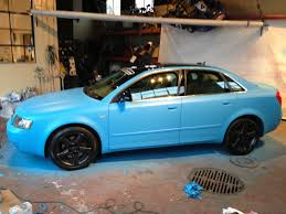 plasti dip wrapped matte baby blue audi a4 with black silver flake