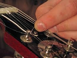 how to restring an electric guitar dummies
