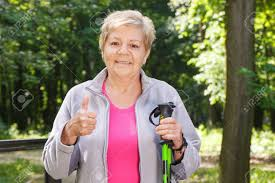 elderly woman clothes elderly senior woman in sporty clothes holding nordic walking
