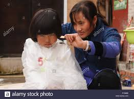 pictures of hair cut for year 5 year old hani chinese girl sulking having her hair cut in street