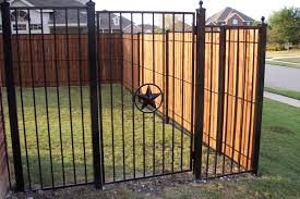 decorating wrought iron fence with bamboo fence roll and natural