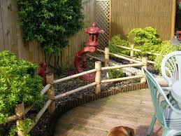 Small Backyard Design Ideas Pictures by Gravel Garden Features Bamboo For Height And Color Bamboo Garden