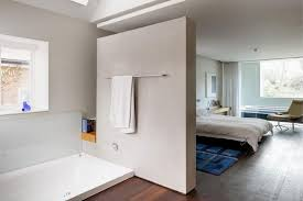 Unique Room Divider Ideas Light Concrete Wall With Towel Hanger As Room Divider