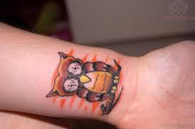 15 amazing brown tattoos on wrist