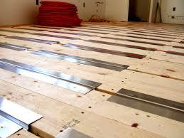 radiant heat prep glued a high density foam board on the