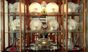 how to arrange dishes in china cabinet decor decorating a china cabinet the enchanted manor