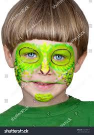 little boy making face painting halloweenchameleon stock photo