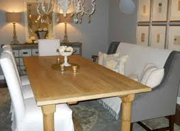 banquette seating dining room farmhouse with books brick accent