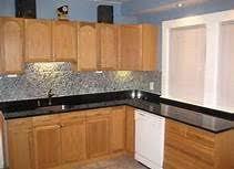 Black Granite Kitchen Countertops by Bright Kitchen With Oak Cabinets Black Granite Counters Tile