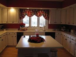 kitchen no backsplash before kitchen no backsplash just red walls white cabinets