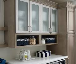 kitchen storage cabinets with doors laundry room storage cabinets kemper cabinetry