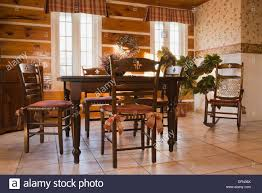 antique style dining table and chairs in the dining room of a 1978