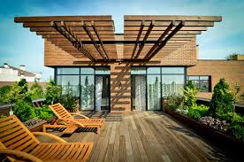 terrace design on the rooftop home with chairs and table made of